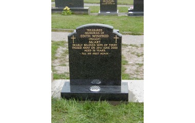 24inch wide, x 30inch high, camber top with ogee shoulders, grey granite, gilded inscription