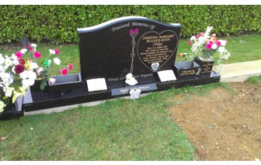 Double- width grave (4ft memorial), ogee with chamfered edges, splayed base, planters and vases, black granite, gilded inscription, painted design