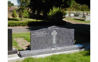 Double- width grave (69 inch wide memorial), bahama blue granite, painted silver inscription and design