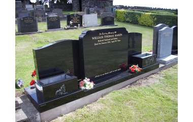 Double- width grave, (3ft wide memorial), black granite with planters, gilded inscription, incised-only designs