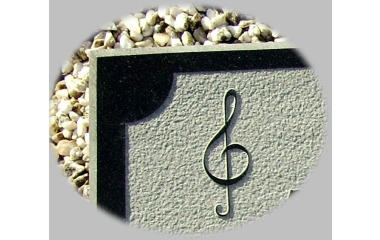 Musical notation, in relief on black granite