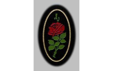 Rose, painted and gilded on black granite