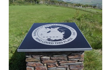 Memorial plaque at Maughold, black granite with part-polished edges, incised-only map