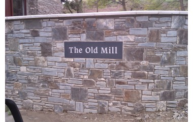 Property name plaque , unpolished black granite, silver painted lettering