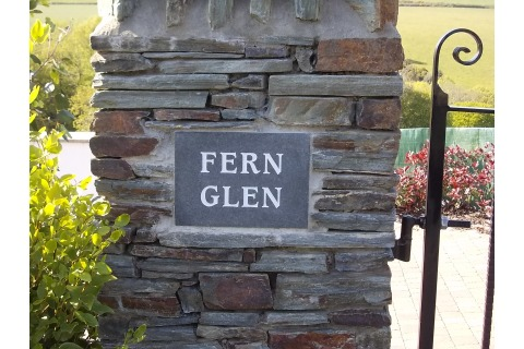 Property name plaque, unpolished black granite, white painted lettering